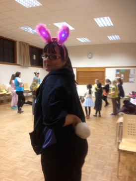 Jenny shows off the bunny tails she made for us to wear for the Brownie Easter party organised by the girls